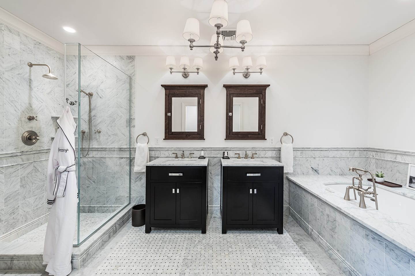 Hiltop 1 Master Bathroom with his and hers sinks, marble detailing, a walk in shower and bathtub
