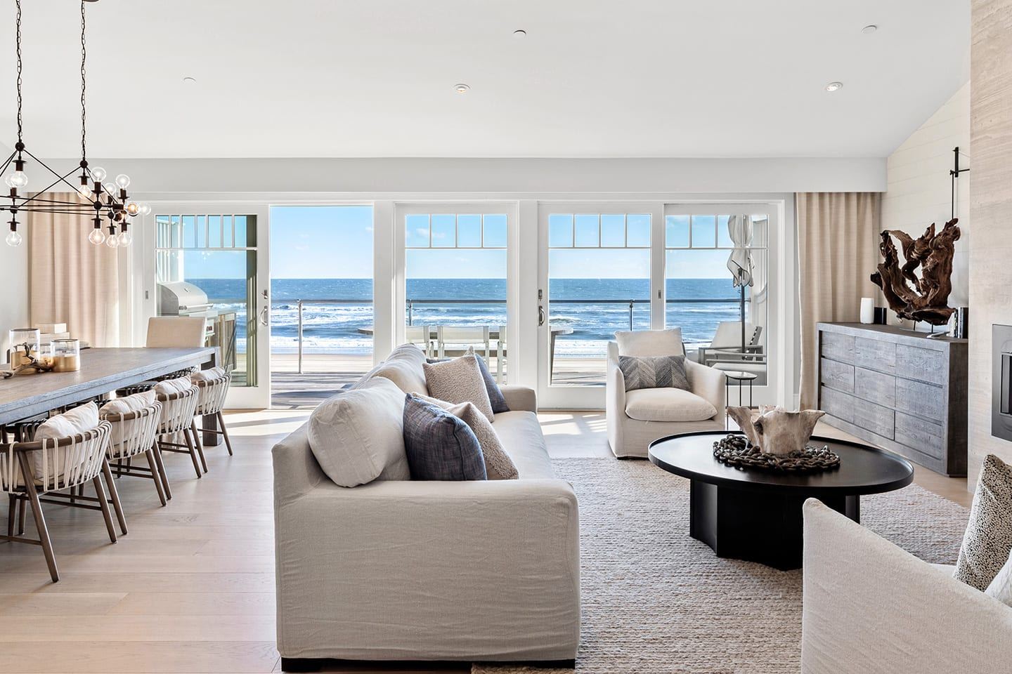 Salt Sea 5 Living room and dining room with a deck overlooking the ocean