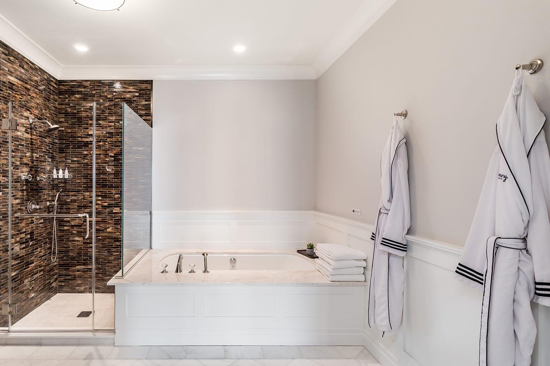 Salt Sea 9 bathroom with glass shower and jacuzzi tub