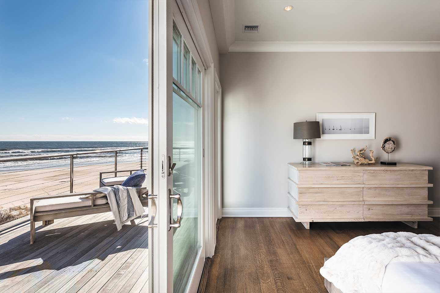 Bedroom and the deck with a ocean view