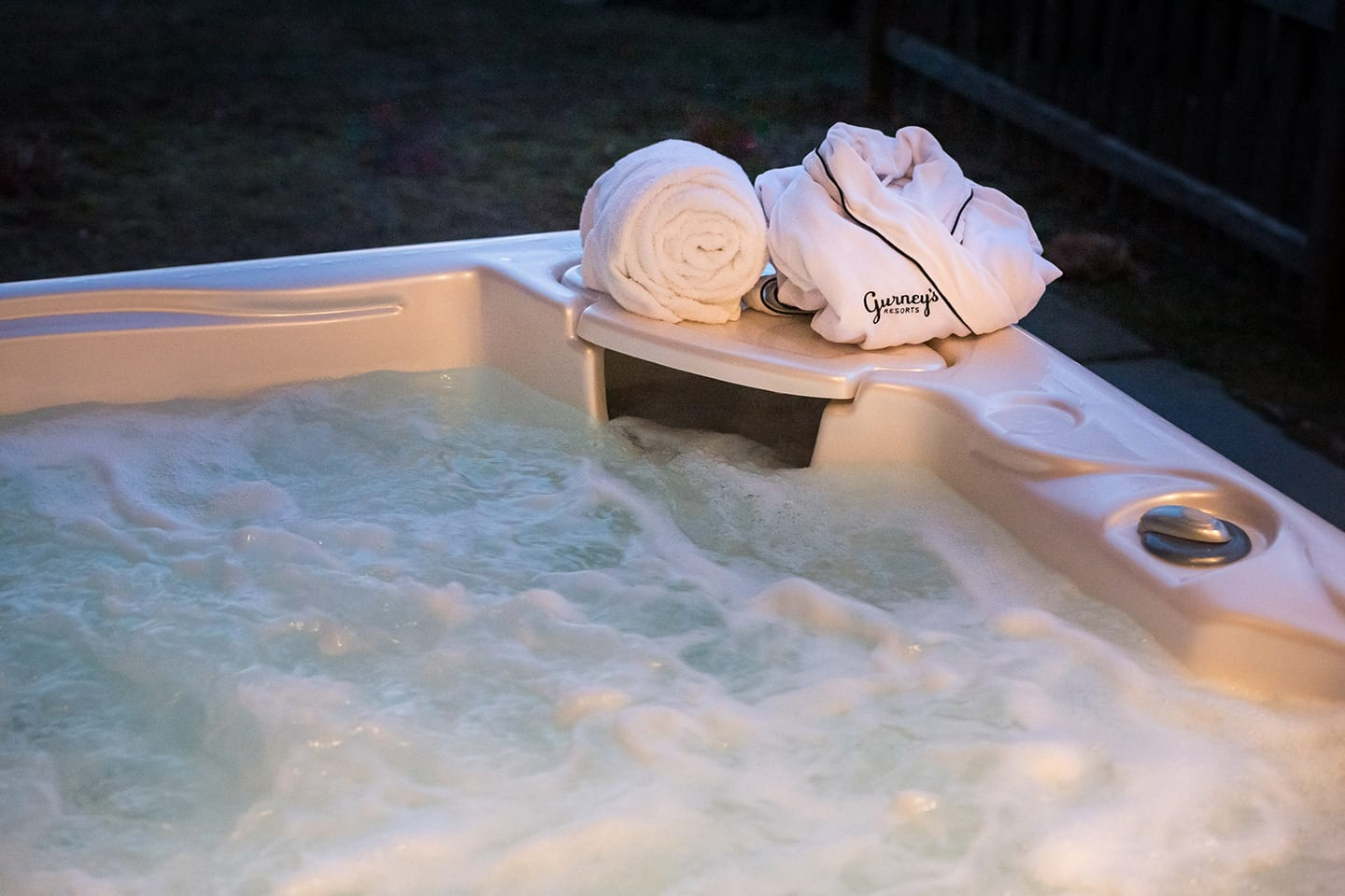 Close up of the jacuzzi with a Gurney's robe and towel