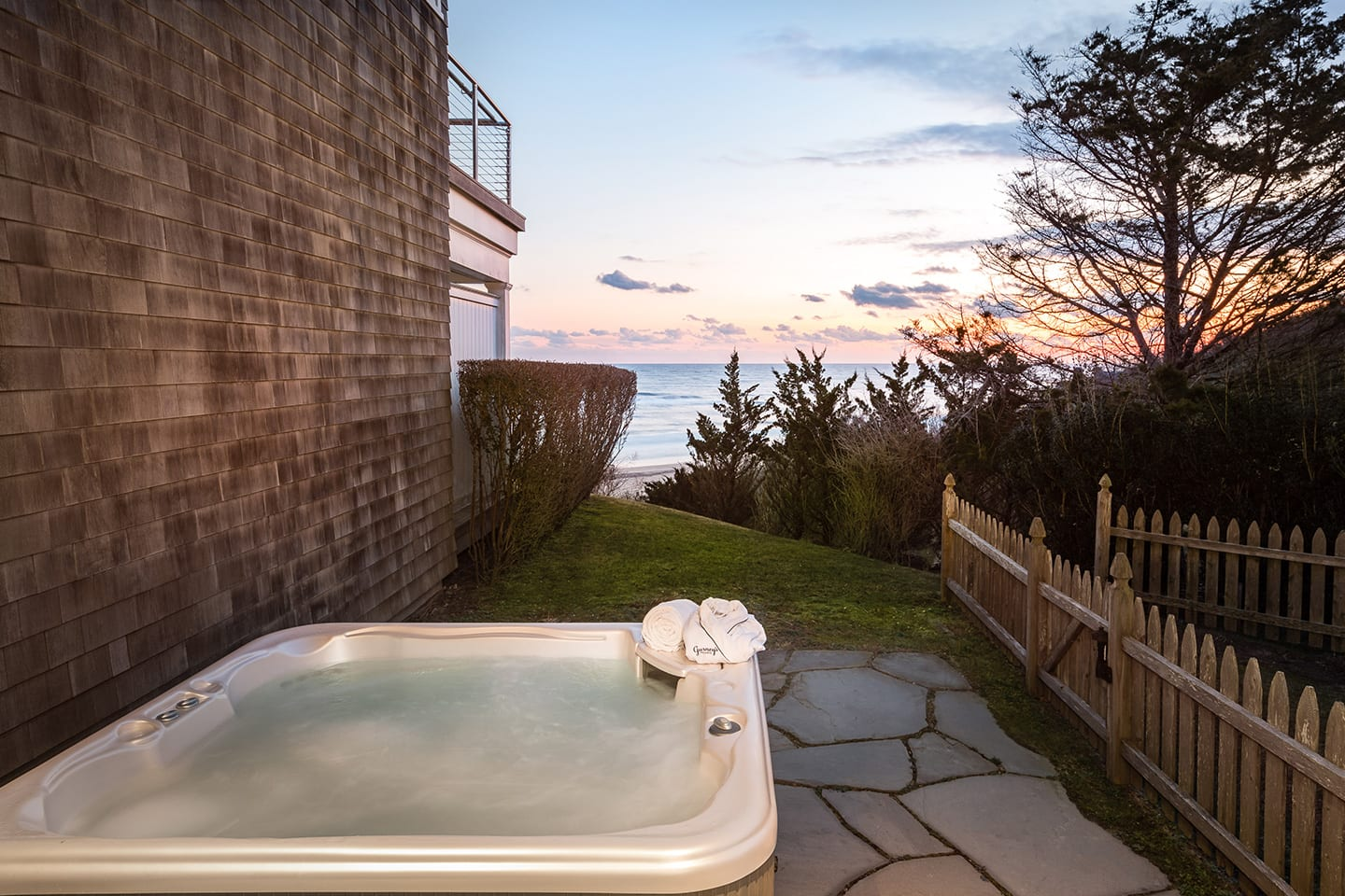 Hilltop 10 Fenced in side patio with a jacuzzi and views of the ocean