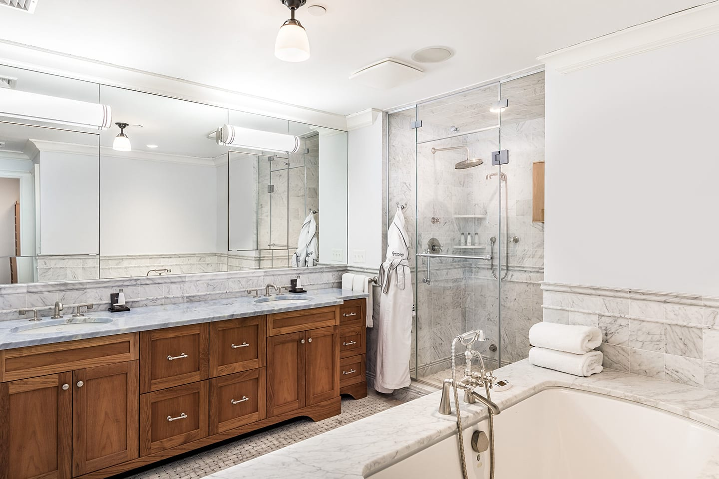 Hiltop 10 Master Bathroom with his and hers sinks, marble detailing, a walk in shower and a bathtub