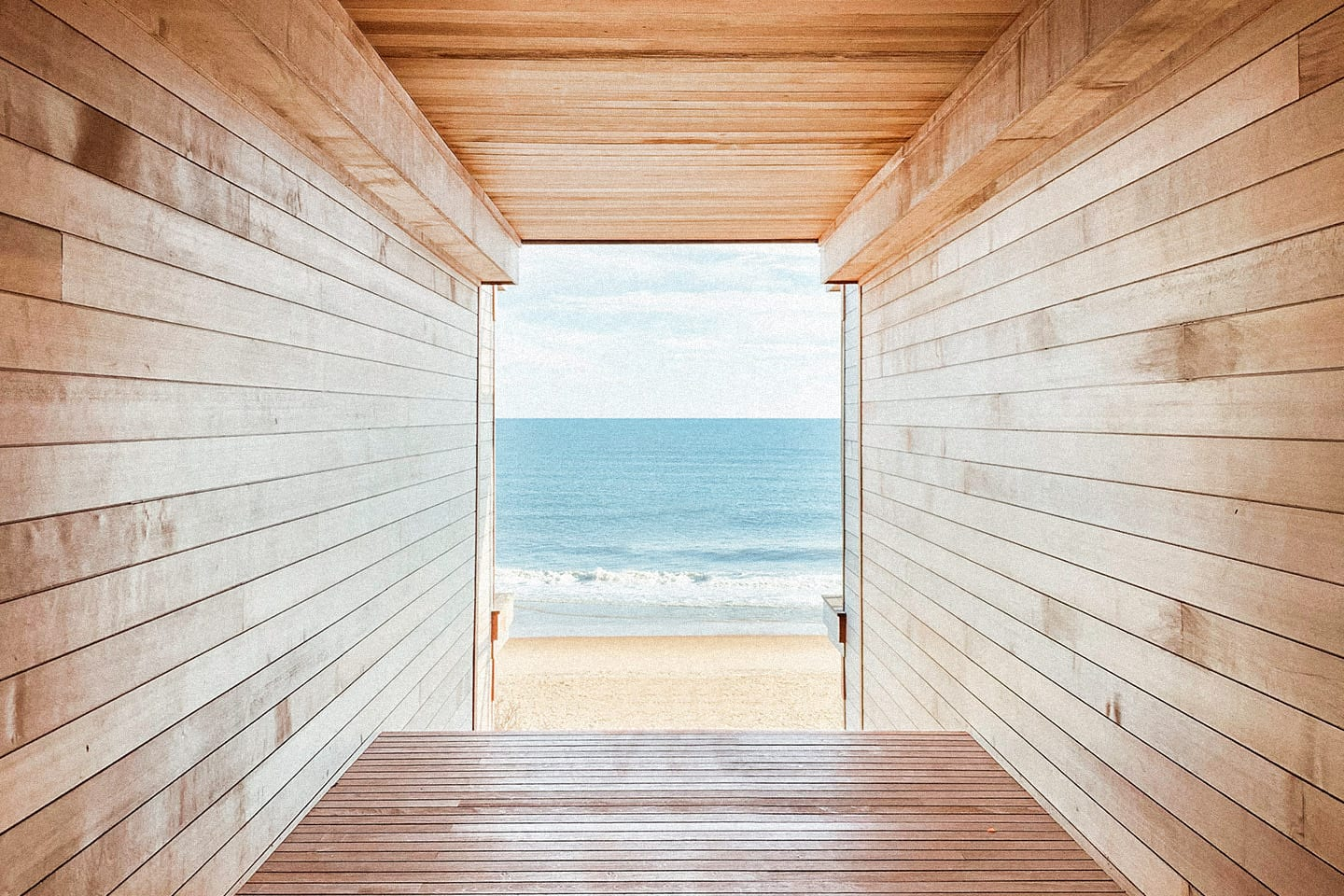 Enclosed walkway looking out at the beach.